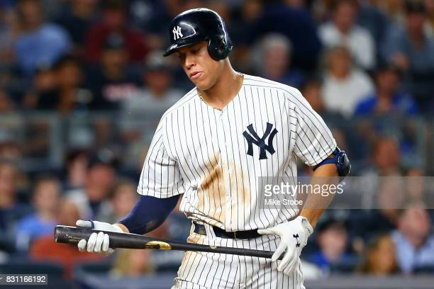 Aaron Judge of the New York Yankees reacts after striking out in the fourth inning against the Boston Red Sox at Yankee Stadium on August 13 2017 in...