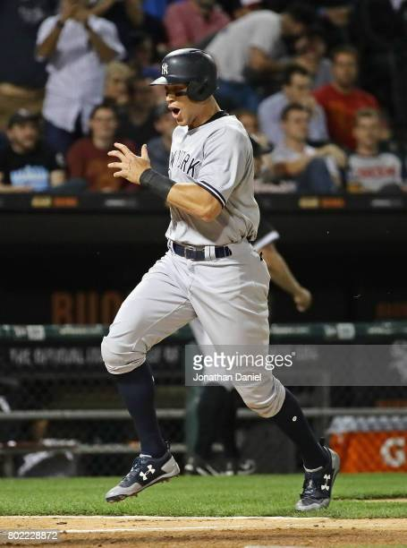 Aaron Judge of the New York Yankees reacts as he comes in to score a run in the 8th inning against the Chicago White Sox at Guaranteed Rate Field on...