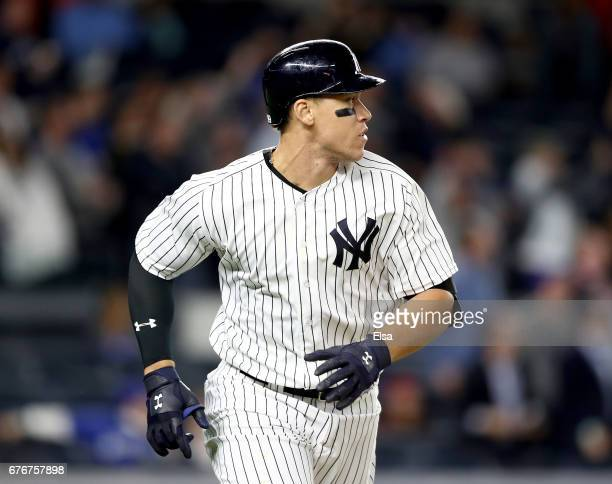 Aaron Judge of the New York Yankees rounds first base after he hit a three run home run in the seventh inning against the Toronto Blue Jays on May 2...
