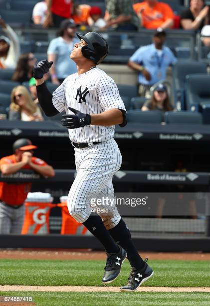 Aaron Judge of the New York Yankees rounds the bases after hitting a tworun home run against Jayson Aquino of the Baltimore Orioles in the seventh...