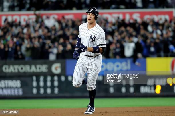 Aaron Judge of the New York Yankees rounds the bases after hitting a 3run home run during the fourth inning against the Houston Astros in Game Three...