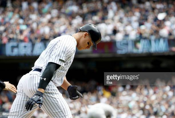 Aaron Judge of the New York Yankees rounds third base after he hits his first career grand slam in the third inning against the Oakland Athletics on...