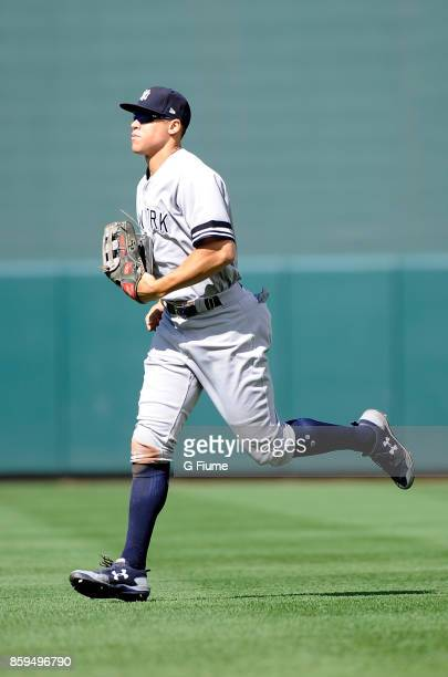 Aaron Judge of the New York Yankees runs in from the outfield during the game against the Baltimore Orioles at Oriole Park at Camden Yards on...