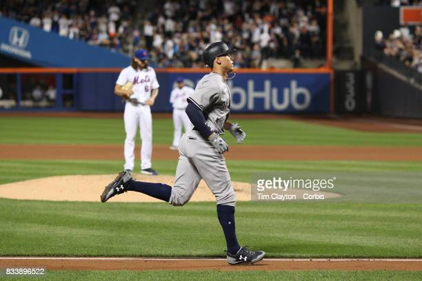 Aaron Judge of the New York Yankees runs the bases after hitting a solo home run off pitcher Robert Gsellman of the New York Mets in the fourth...