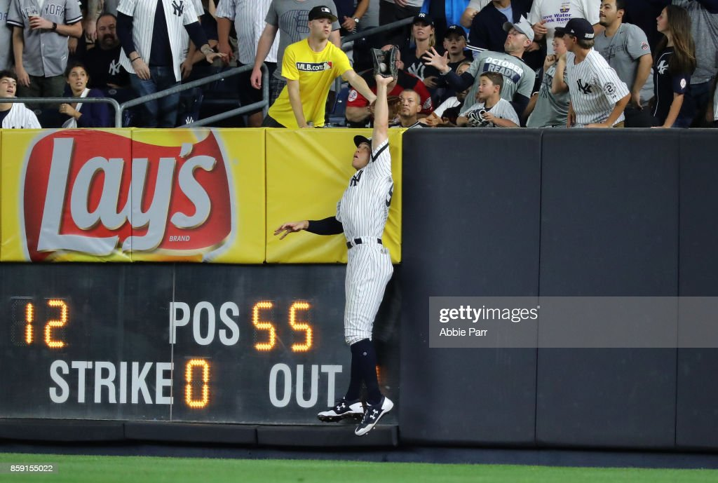 Aaron Judge #99 of the New York Yankees saves a home run with a catch of a deep fly ball during the sixth inning against the Cleveland Indians in game three of the American League Division Series at Yankee Stadium on October 8, 2017 in New York City.