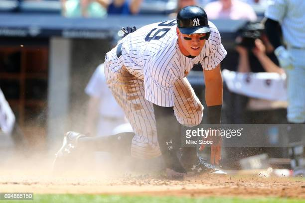Aaron Judge of the New York Yankees scores on teammateStarlin Castro 2run single in the first inning against the Baltimore Orioles at Yankee Stadium...