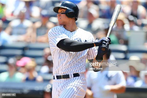 Aaron Judge of the New York Yankees singles to right field in the first inning against the Baltimore Orioles at Yankee Stadium on June 11 2017 in the...