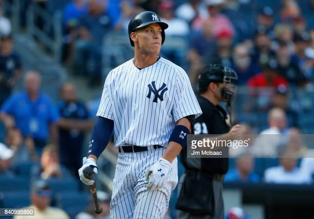 Aaron Judge of the New York Yankees walks off the field after striking out to end the first game of a doubleheader against the Cleveland Indians at...