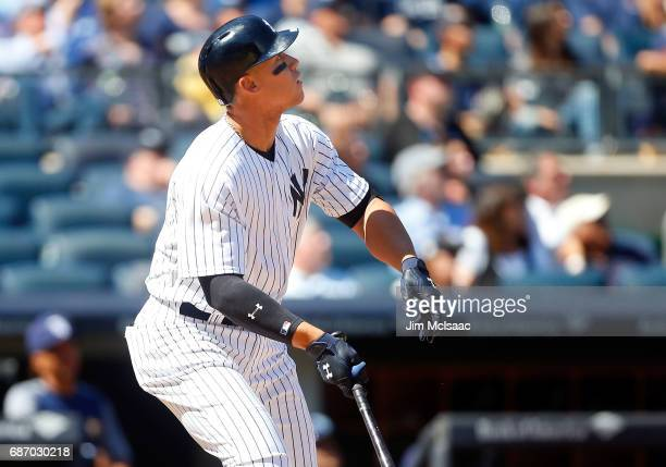 Aaron Judge of the New York Yankees watches his fourth inning home run against the Tampa Bay Rays on Opening Day at Yankee Stadium on April 10 2017...