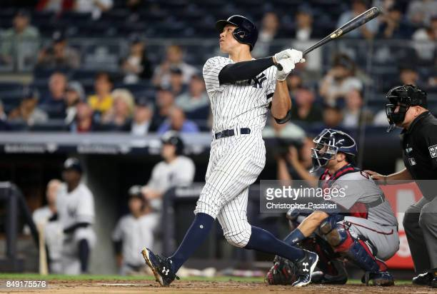 Aaron Judge of the New York Yankees watches his solo homerun in the bottom of the first inning against the Minnesota Twins on September 18 2017 at...