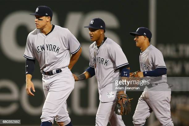 Aaron Judge Starlin Castro and Ronald Torreyes of the New York Yankees high five each other after their victory over the Boston Red Sox at Fenway...