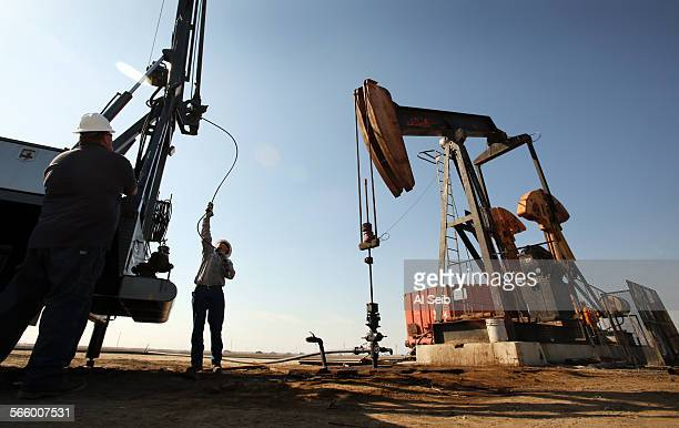 Aaron Kent a wireline operator for Canary LLC prepares a slick line at an oil rig pump jack site in the oil fields near Bakersfield on March 13 2013...