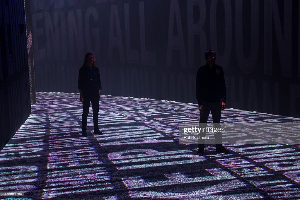 Aaron Koblin and Ben Tricklebank stand in their 'Light Echoes' installation at the 'Station to Station A 30 Day Happening' opening party at Barbican...