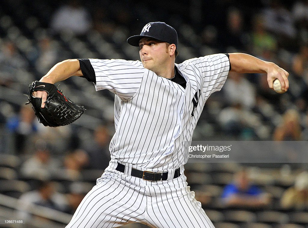 <a gi-track='captionPersonalityLinkClicked' href=/galleries/search?phrase=Aaron+Laffey&family=editorial&specificpeople=4175149 ng-click='$event.stopPropagation()'>Aaron Laffey</a> #22 of the New York Yankees throws a pitch in the top of the 13th inning against the Boston Red Sox on September 25, 2011 at Yankee Stadium in the Bronx borough of New York City.