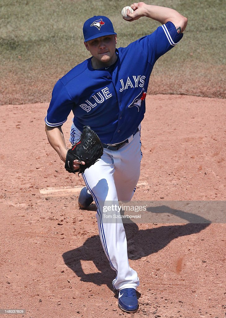 <a gi-track='captionPersonalityLinkClicked' href=/galleries/search?phrase=Aaron+Laffey&family=editorial&specificpeople=4175149 ng-click='$event.stopPropagation()'>Aaron Laffey</a> #32 of the Toronto Blue Jays delivers a pitch during MLB game action against the Cleveland Indians on July 14, 2012 at Rogers Centre in Toronto, Ontario, Canada.