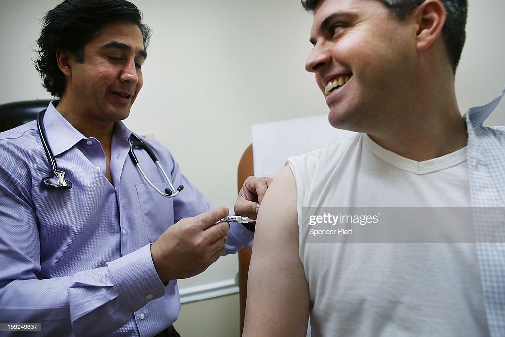 Aaron Lemma recieves a flu shot by Dr. Sassan Naderi at the Premier Care walk-in health clinic which administers flu shots on January 10, 2013 in New York City. The Flu season has hit parts of the country particularly hard this year with Boston declaring a public health emergency and a Pennsylvania hospital constructing a tent to handle excess flu cases.According to the Centers for Disease Control and Prevention, 22,048 flu cases have been reported from September 30 through the end of 2012.