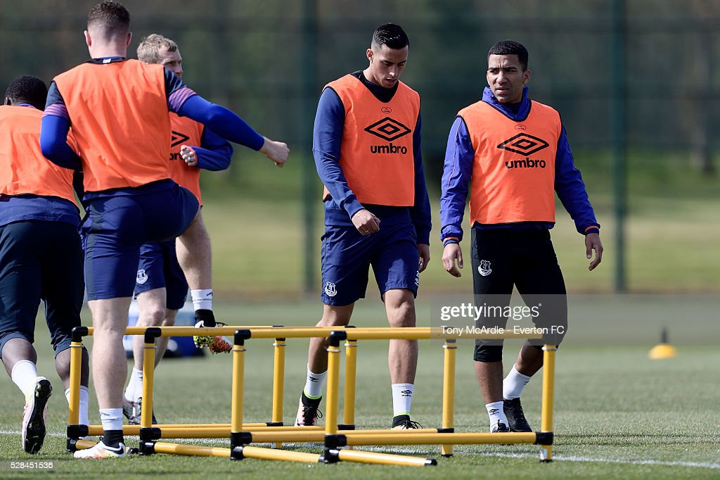 Aaron Lennon (R) and Ramiro Funes Mori during the Everton training session at Finch Farm on May 5, 2016 in Halewood, England.