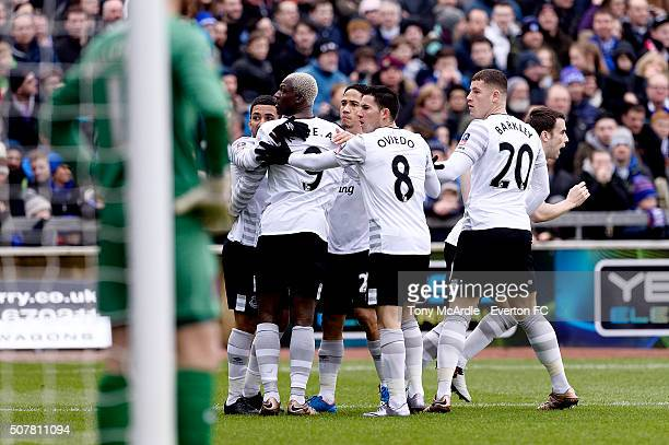 Aaron Lennon Arouna Kone Steven Pienaar Bryan Oviedo and Ross Barkley of Everton react to comments from the crowd after Everton's first goal during...