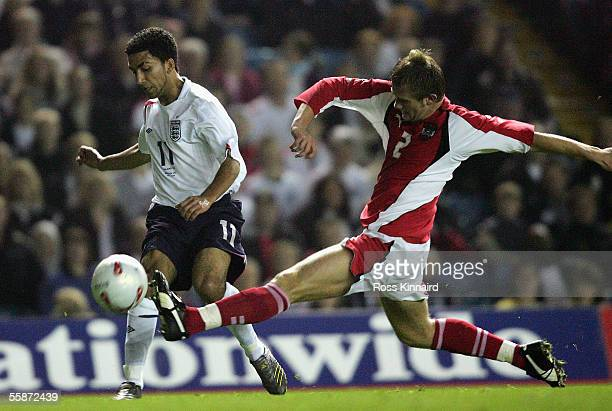 Aaron Lennon of England is challenged by Mario Sonnleitner of Austria during the European U21 Championship Qualiying match between England U21 and...