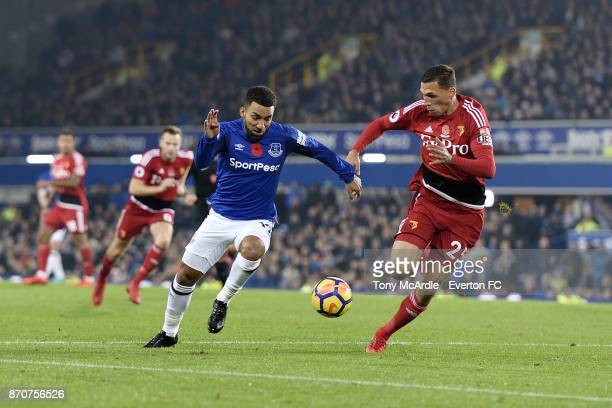Aaron Lennon of Everton and Jose Holebas challenge for the ball during the Premier League match between Everton and Watford at Goodison Park on...