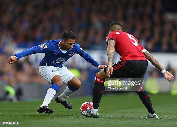 Aaron Lennon of Everton and Marcos Roja of Manchester United compete for the ball during the Barclays Premier League match between Everton and...