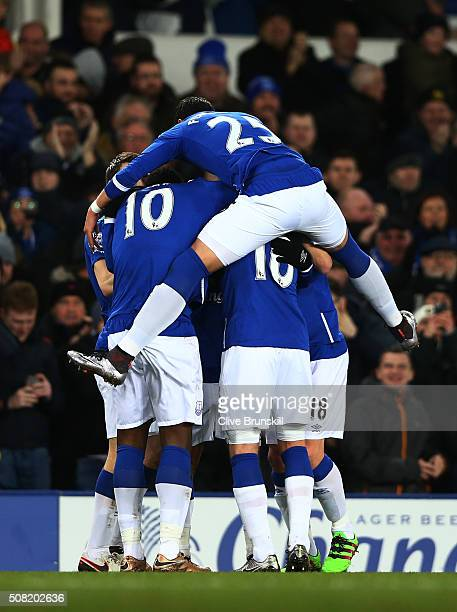Aaron Lennon of Everton celebrates with teammates after scoring the opening goal during the Barclays Premier League match between Everton and...