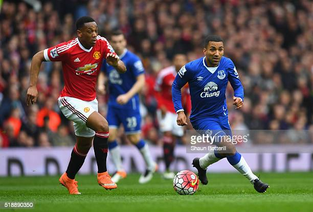 Aaron Lennon of Everton is chased by Anthony Martial of Manchester United during the Barclays Premier League match between Manchester United and...