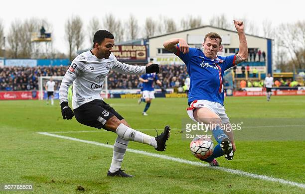 Aaron Lennon of Everton is closed down by Mark Ellis of Carlisle United during the Emirates FA Cup Fourth Round match between Carlisle United and...