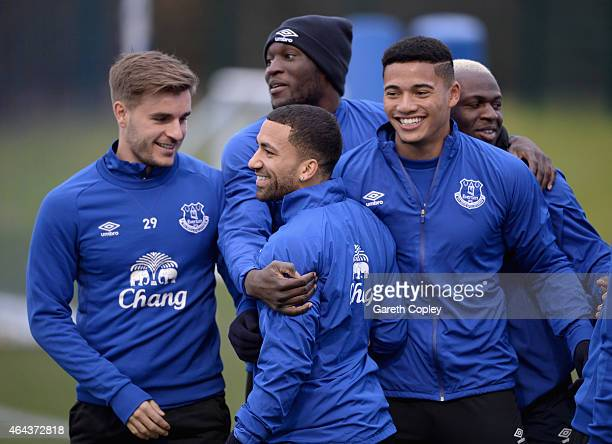 Aaron Lennon of Everton is hugged by teammmates Luke Garbutt Romelu Lukaku and Tyias Browning during a training session at Finch Farm on February 25...