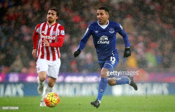 Aaron Lennon of Everton runs with the ball to score his team's third goal during the Barclays Premier League match between Stoke City and Everton at...