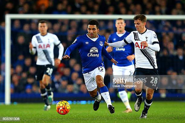 Aaron Lennon of Everton runs with the ball under pressure from Tom Carroll of Tottenham Hotspur during the Barclays Premier League match between...