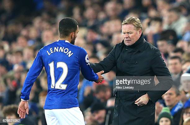 Aaron Lennon of Everton shakes hands with Ronald Koeman Manager of Everton as he is substituted in the second half during the Premier League match...