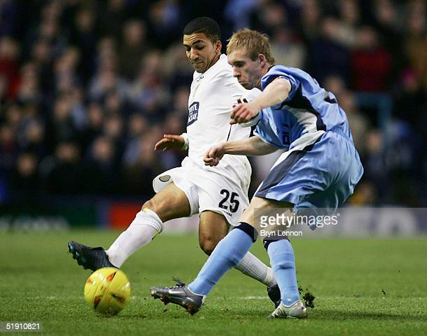 Aaron Lennon of Leeds United is tackled Stuart Giddings of Coventry City during the CocaCola Football League Championship match between Coventry City...