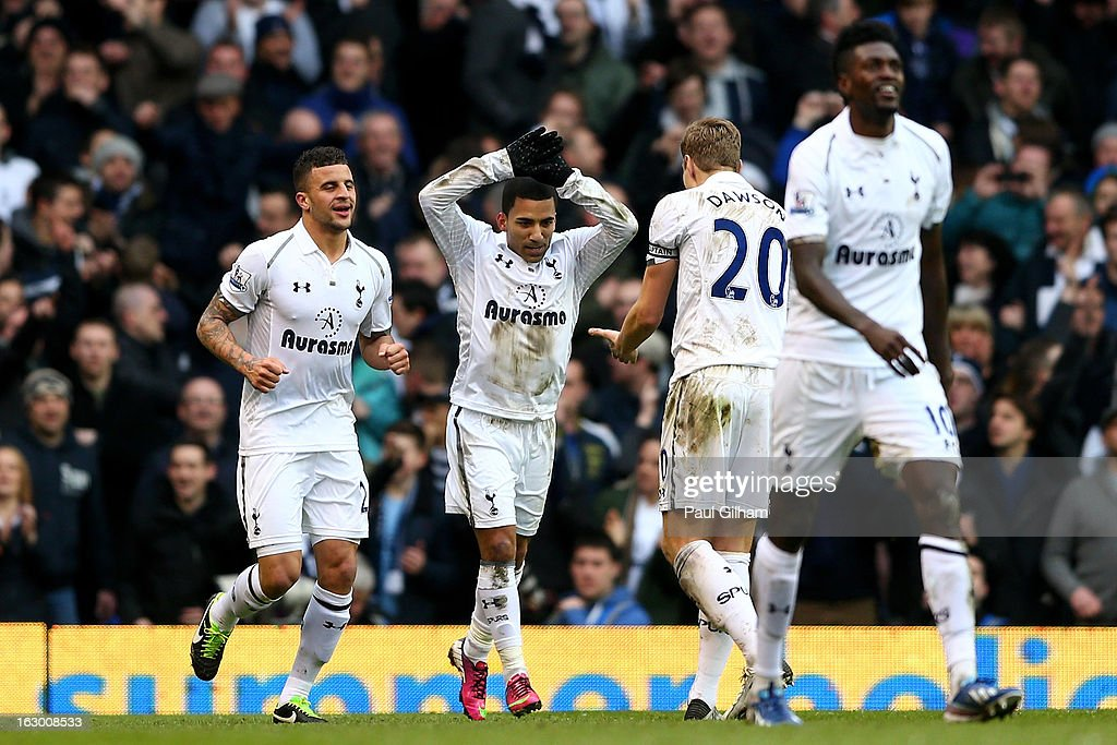 <a gi-track='captionPersonalityLinkClicked' href=/galleries/search?phrase=Aaron+Lennon&family=editorial&specificpeople=453309 ng-click='$event.stopPropagation()'>Aaron Lennon</a> of Spurs celebrates with his captain <a gi-track='captionPersonalityLinkClicked' href=/galleries/search?phrase=Michael+Dawson&family=editorial&specificpeople=453217 ng-click='$event.stopPropagation()'>Michael Dawson</a> after scoring his team's second goal during the Barclays Premier League match between Tottenham Hotspur and Arsenal FC at White Hart Lane on March 3, 2013 in London, England.