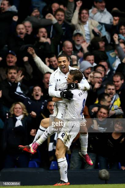 Aaron Lennon of Spurs celebrates with teammate Scott Parker after scoring his team's second goal during the Barclays Premier League match between...