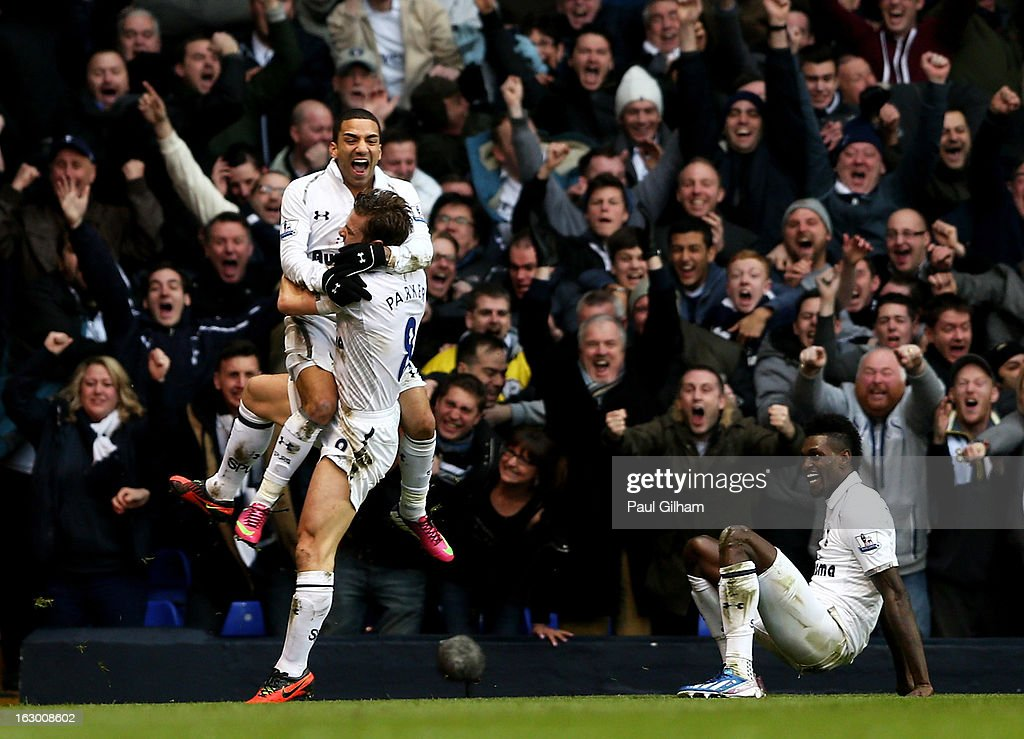 Aaron Lennon of Spurs celebrates with teammate Scott Parker after scoring his team's second goal during the Barclays Premier League match between Tottenham Hotspur and Arsenal FC at White Hart Lane on March 3, 2013 in London, England.