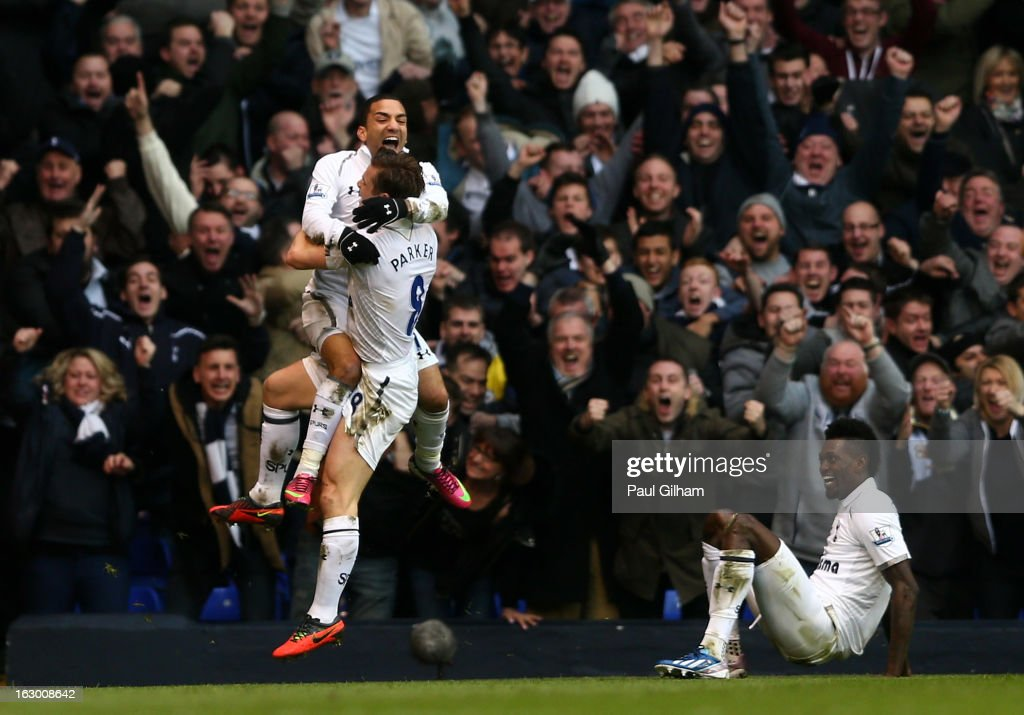 <a gi-track='captionPersonalityLinkClicked' href=/galleries/search?phrase=Aaron+Lennon&family=editorial&specificpeople=453309 ng-click='$event.stopPropagation()'>Aaron Lennon</a> of Spurs celebrates with teammate Scott Parker after scoring his team's second goal during the Barclays Premier League match between Tottenham Hotspur and Arsenal FC at White Hart Lane on March 3, 2013 in London, England.