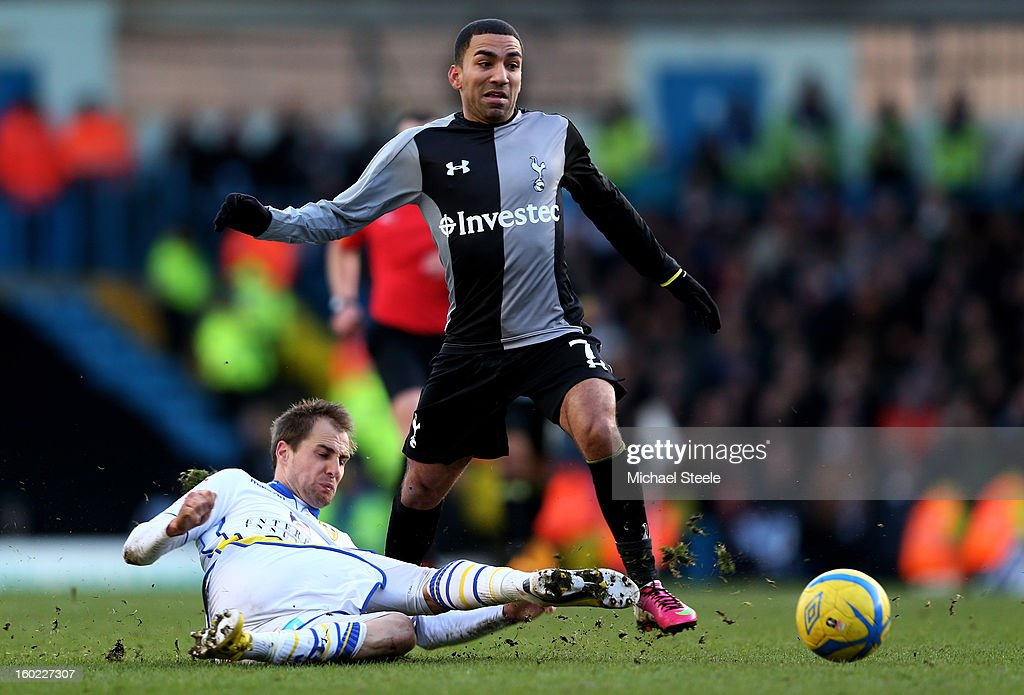 Aaron Lennon of Spurs is tackled by Luke Varney of Leeds during the FA Cup with Budweiser Fourth Round match between Leeds United and Tottenham Hotspur at Elland Road on January 27, 2013 in Leeds, England.