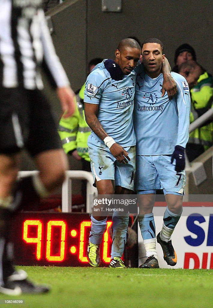 Aaron Lennon of Tottenham celebrates the equalizing goal with Jermain Defoe (left) during the Barclays Premier league match between Newcastle United and Tottenham Hotspur at St James' Park on January 22, 2011 in Newcastle upon Tyne, United Kingdom.