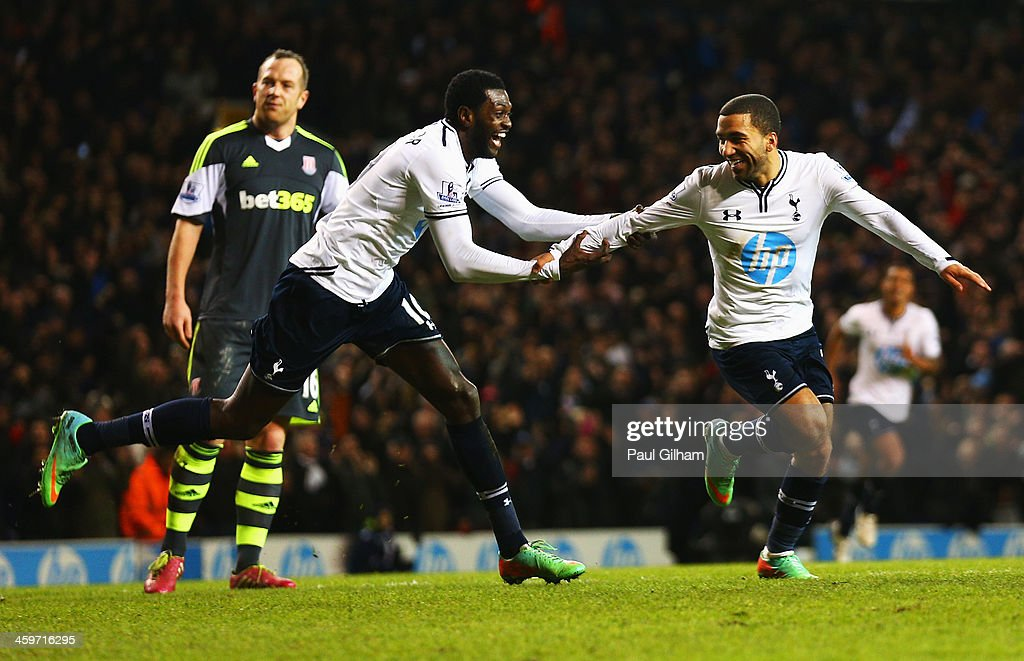 <a gi-track='captionPersonalityLinkClicked' href=/galleries/search?phrase=Aaron+Lennon&family=editorial&specificpeople=453309 ng-click='$event.stopPropagation()'>Aaron Lennon</a> of Tottenham Hotspur celebrates his team's third goal with <a gi-track='captionPersonalityLinkClicked' href=/galleries/search?phrase=Emmanuel+Adebayor&family=editorial&specificpeople=484018 ng-click='$event.stopPropagation()'>Emmanuel Adebayor</a> (L) during the Barclays Premier League match between Tottenham Hotspur and Stoke City at White Hart Lane on December 29, 2013 in London, England.