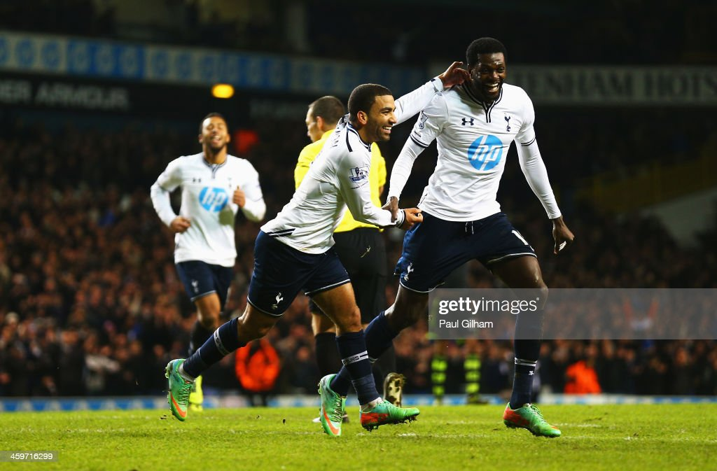 Aaron Lennon of Tottenham Hotspur celebrates his team's third goal with Emmanuel Adebayor (R) during the Barclays Premier League match between Tottenham Hotspur and Stoke City at White Hart Lane on December 29, 2013 in London, England.