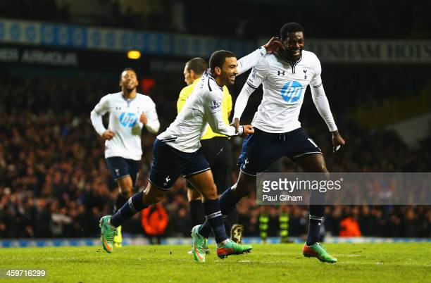 Aaron Lennon of Tottenham Hotspur celebrates his team's third goal with Emmanuel Adebayor during the Barclays Premier League match between Tottenham...