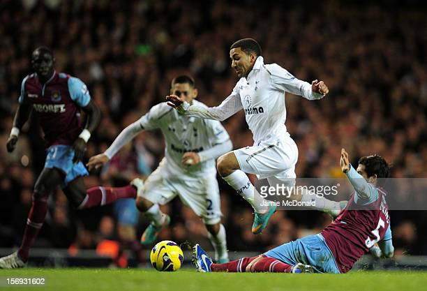 Aaron Lennon of Tottenham Hotspur evades the tackle from James Tomkins of West Ham United during the Barclays Premier League match between Tottenham...