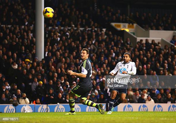 Aaron Lennon of Tottenham Hotspur scores his team's third goal during the Barclays Premier League match between Tottenham Hotspur and Stoke City at...