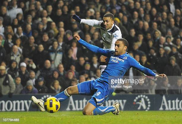 Aaron Lennon of Tottenham Hotspur shoots to score the opening goal during the Barclays Premier League match between Tottenham Hotspur and Newcastle...