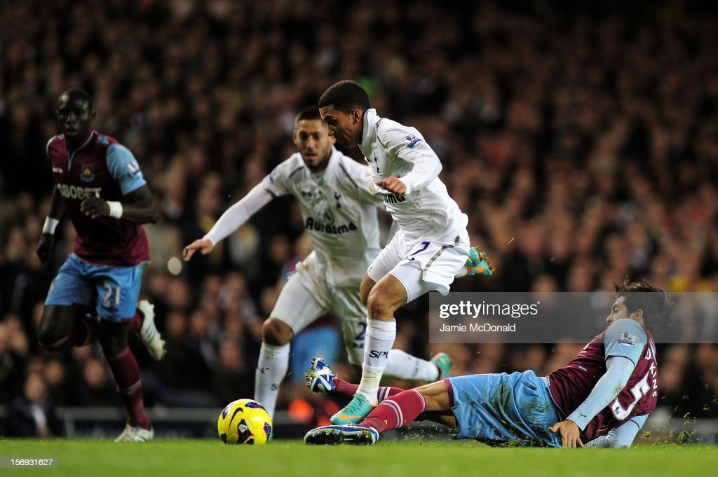 Aaron Lenon of Tottenham Hotspur evades the tackle from James Tomkins of West Ham United during the Barclays Premier League match between Tottenham Hotspur and West Ham United at White Hart Lane on November 25, 2012 in London, England.