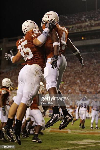 Aaron Lewis and Drew Kelson of the Texas Longhorns celebrate with a chest bump after recovering a fumble on a kickoff to the TCU Horned Frogs in the...