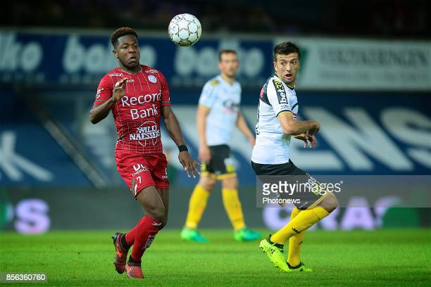 Aaron Leya Iseka forward of SV Zulte Waregem and and Killian Overmeire midfielder of Sporting Lokeren pictured during the Jupiler Pro League match...