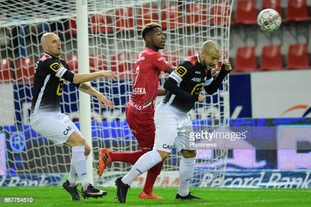 Aaron Leya Iseka forward of SV Zulte Waregem in between Tim Matthys midfielder of KV Mechelen and Yohan Croizet midfielder of KV Mechelen during the...