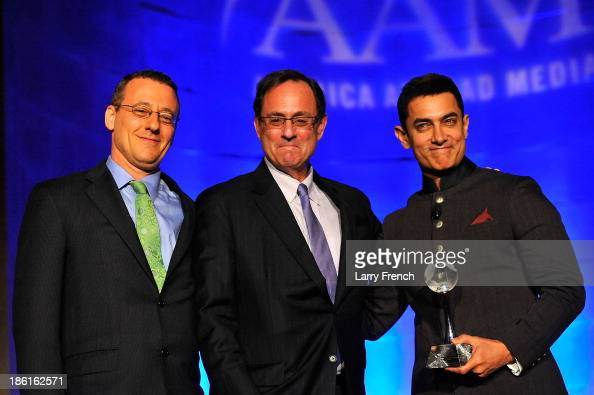 Aaron Lobel Doug Wilson and Aamir Kahn attend the 2013 America Abroad Media Awards Dinner at Andrew W Mellon Auditorium on October 28 2013 in...
